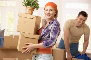 bigstock-Happy-couple-carrying-boxes-at-13113572